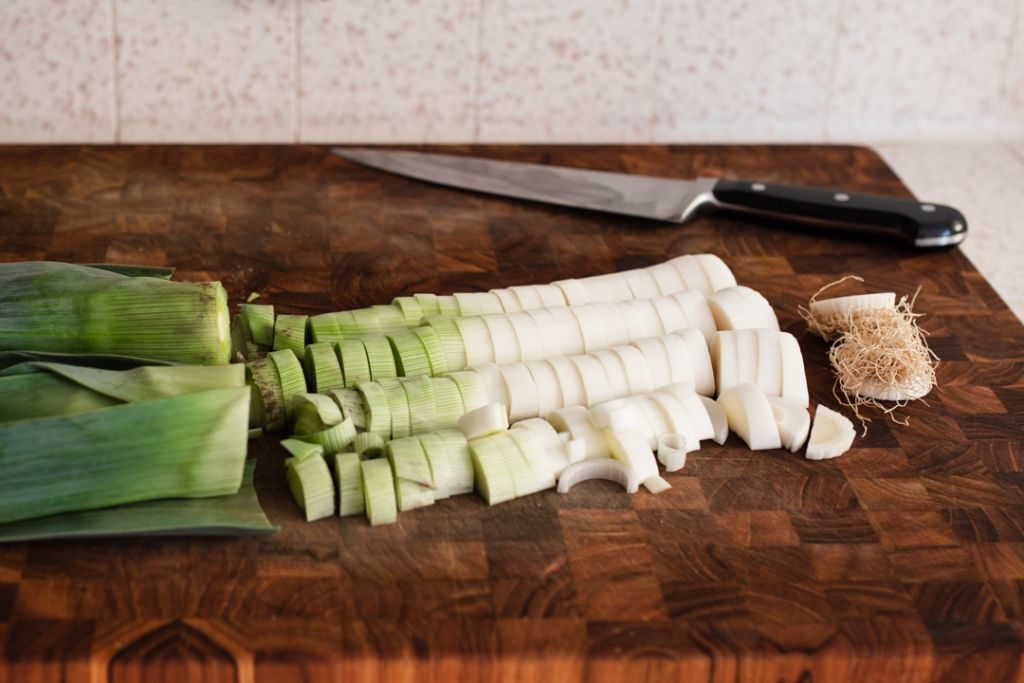 chopped leeks on cutting board
