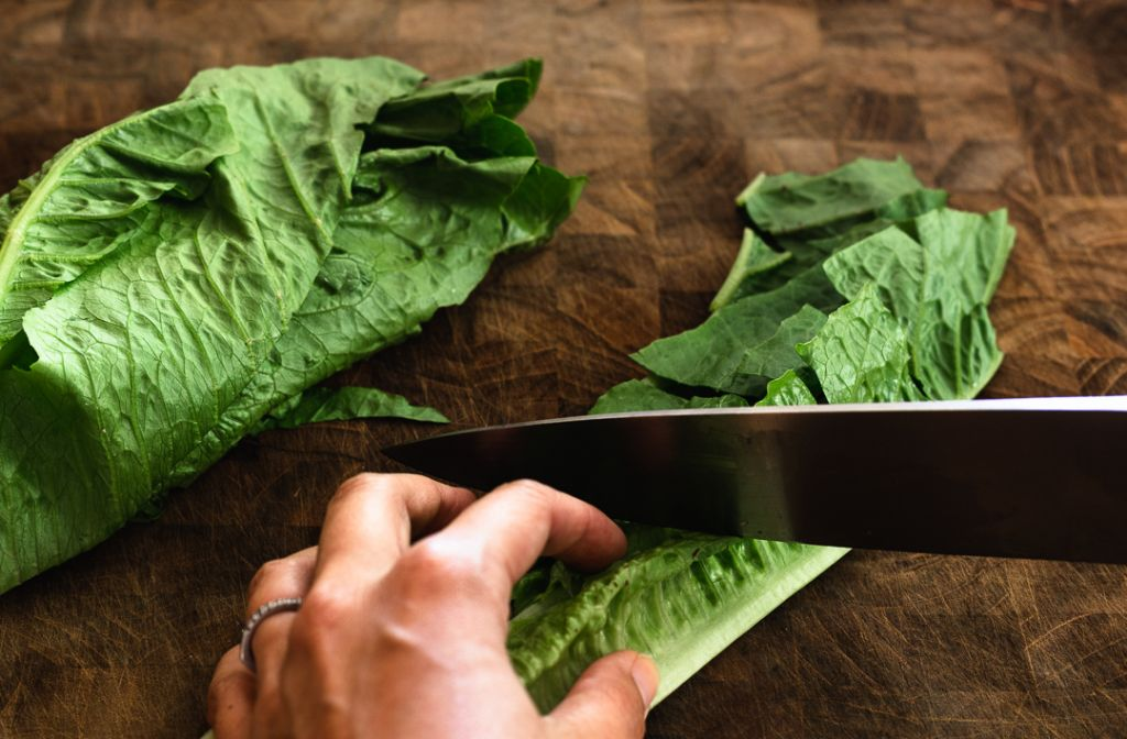 Slicing romaine for caesar salad