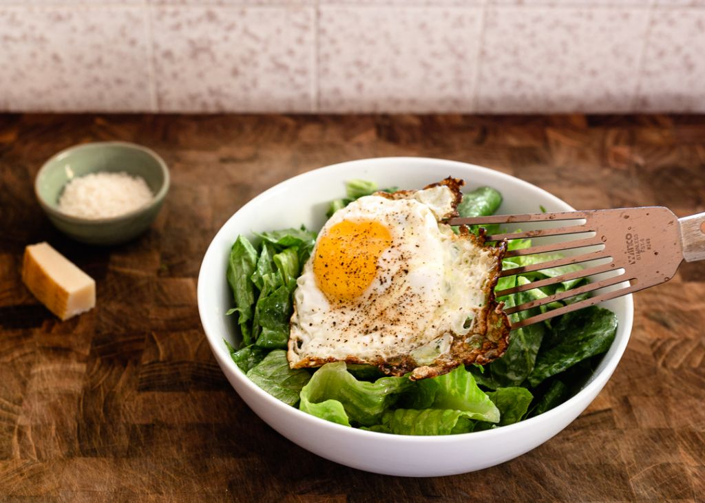 crispy fried egg on salad